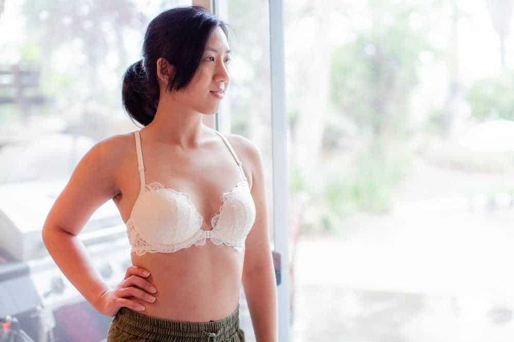 Woman wearing a lacy white bra