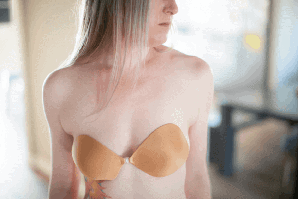 Girl wearing nude adhesive bra underwear