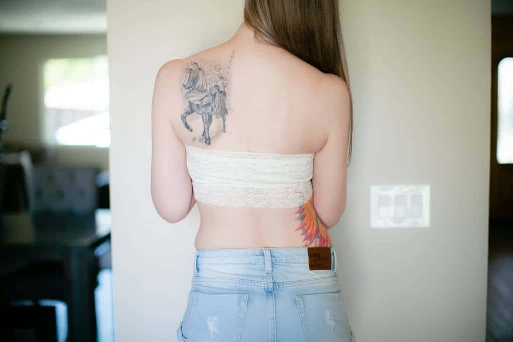girl in a white bandeau tube top with tattoo