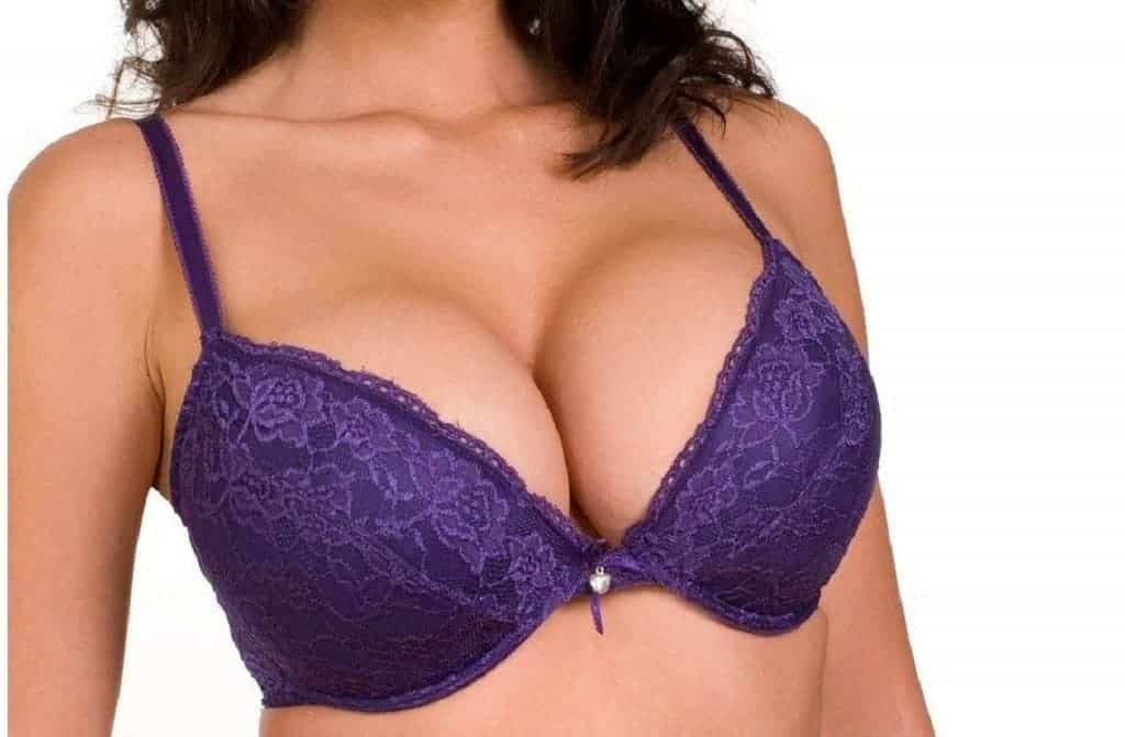 Close up of a woman's chest wearing a blue push up bra
