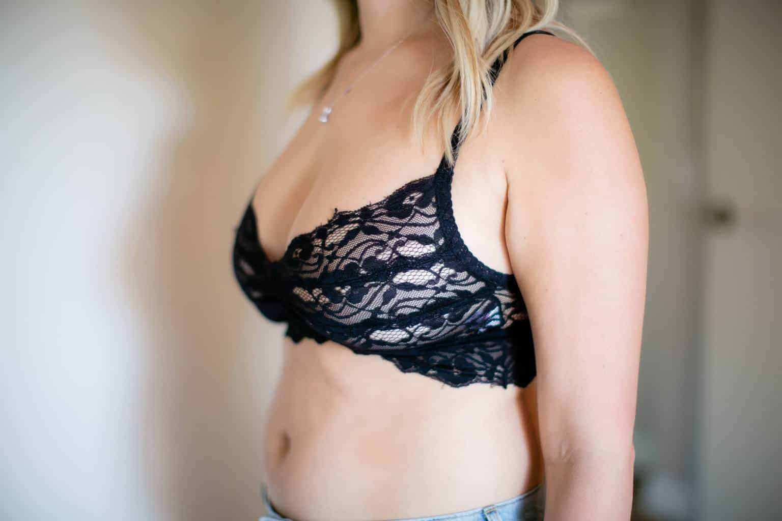 Woman with large boobs wearing a black lace bra