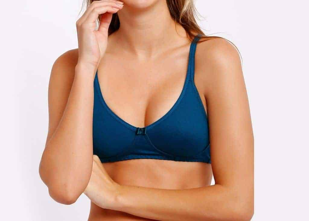Woman wears a dark blue soft cup bra