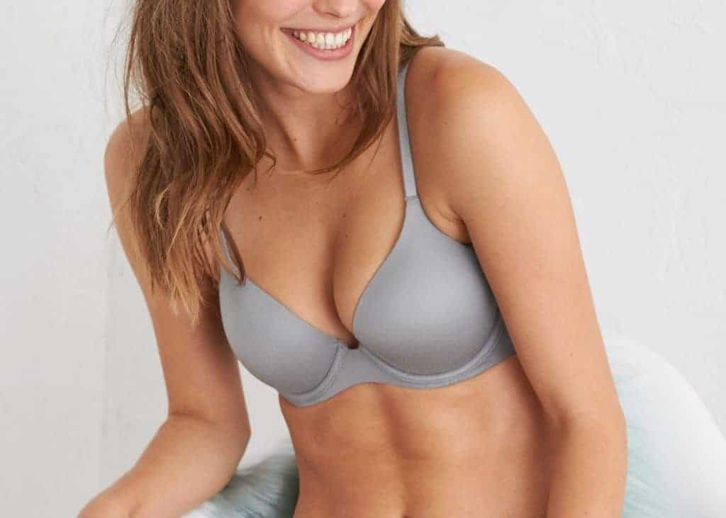 Woman wears a blue bra while laughing