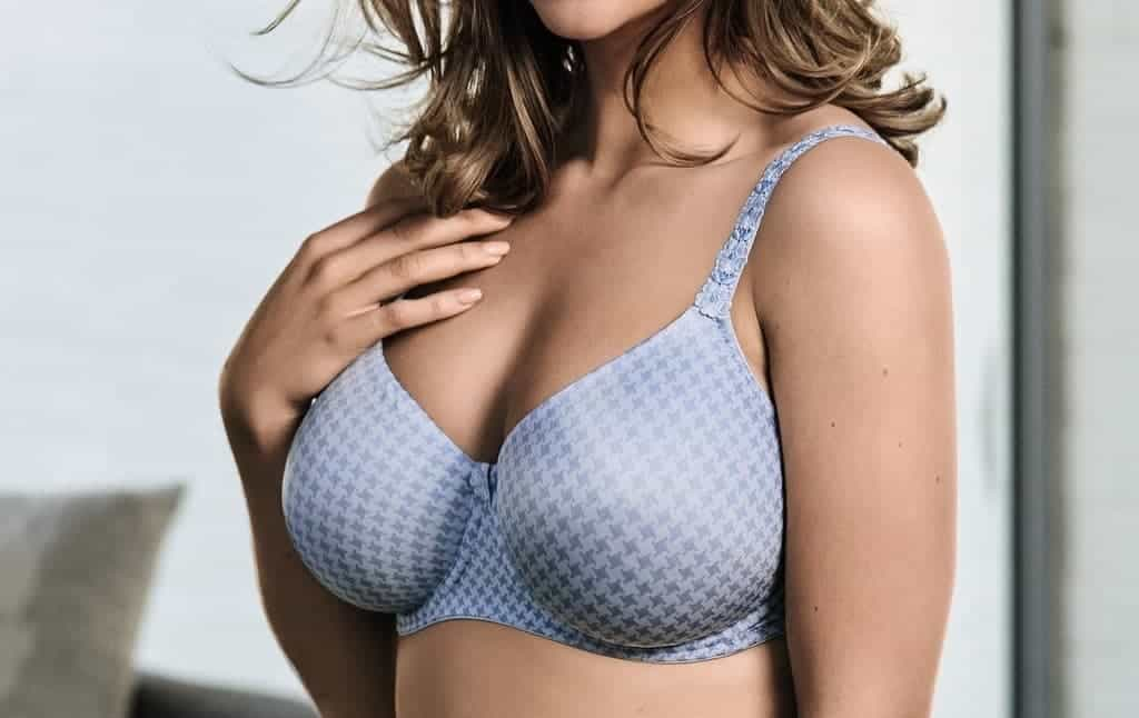 Woman in a purply blue push up bra