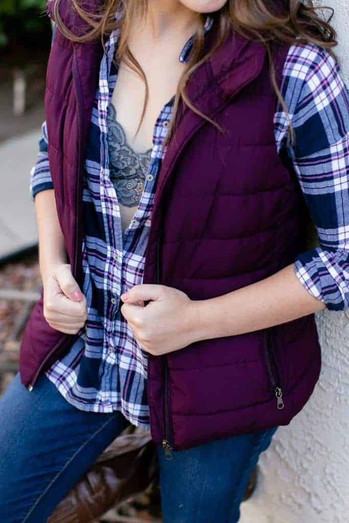 Gray bralette under plaid shirt and purple puffy vest