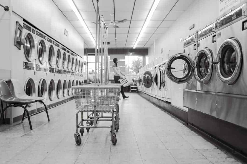 Rows of washing machines in a laundry shop