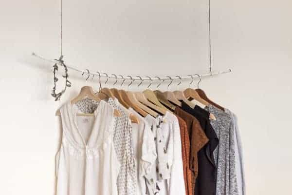 Clothes hanging on a ceiling rack