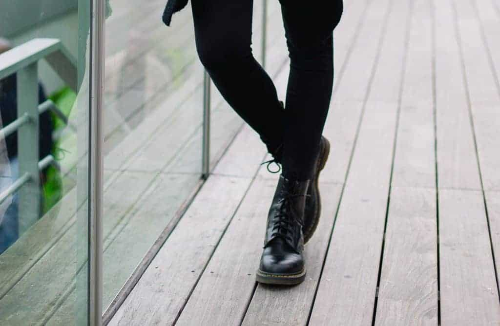 Woman wearing black leggings and some combat boots