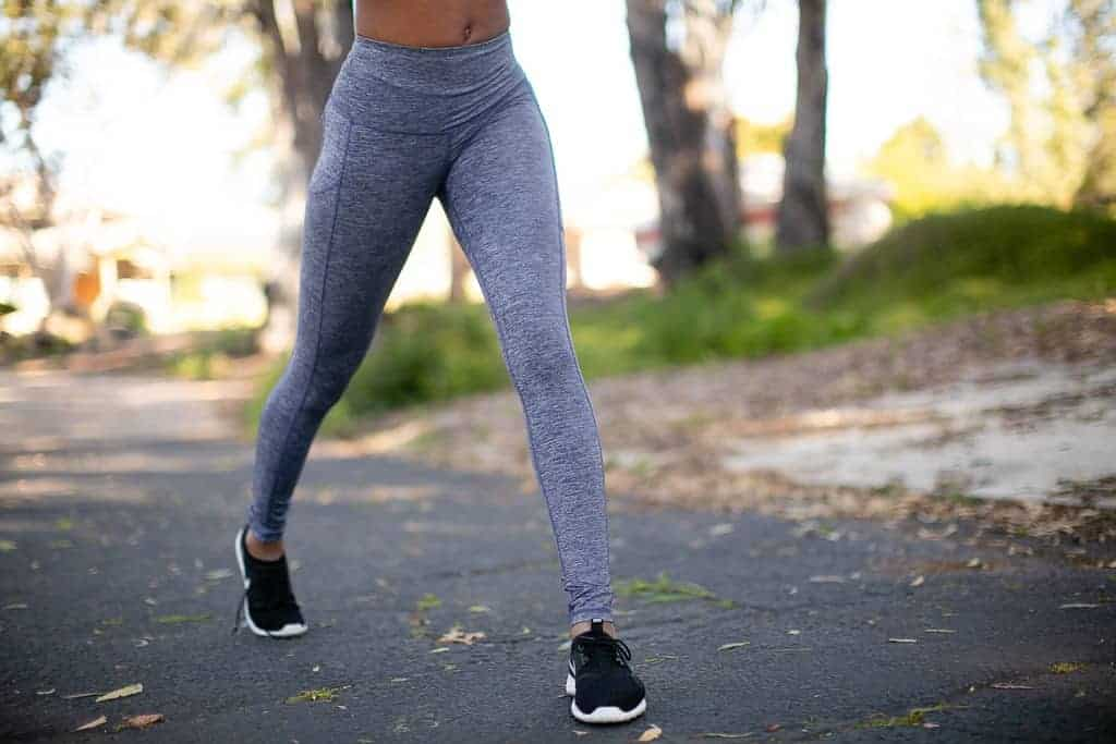 Woman jogging in her gray leggings