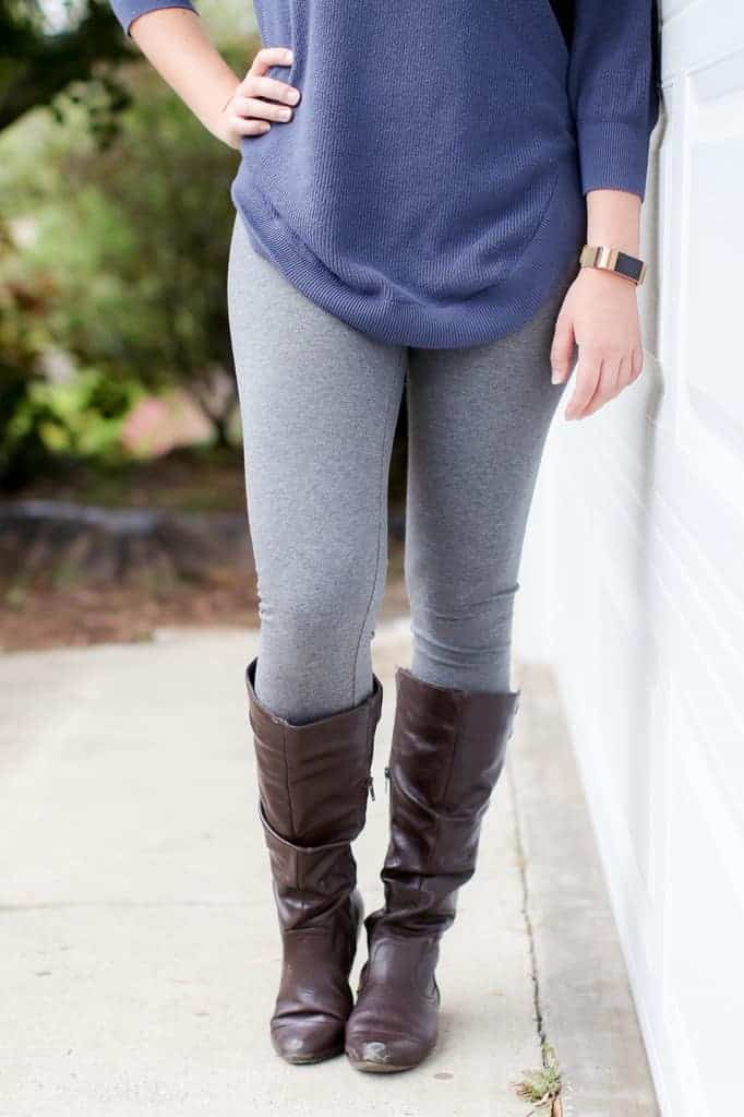 Close up of gray leggings with a blue top and boots