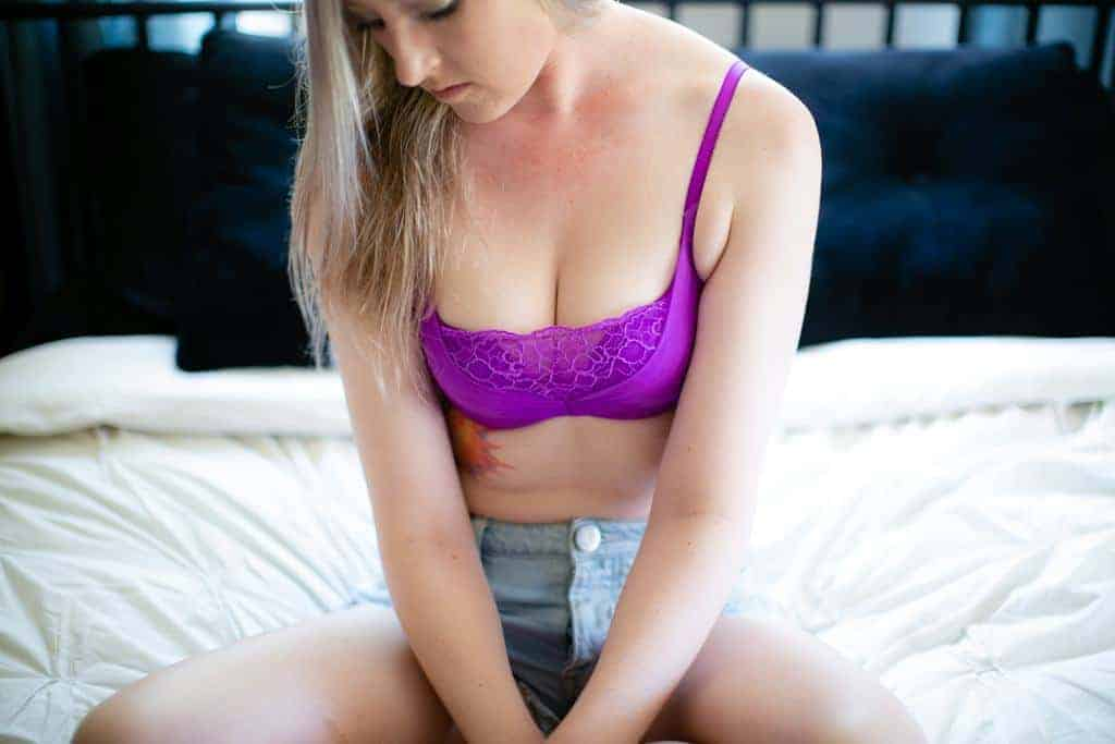 Woman wearing a purple bra on the bed