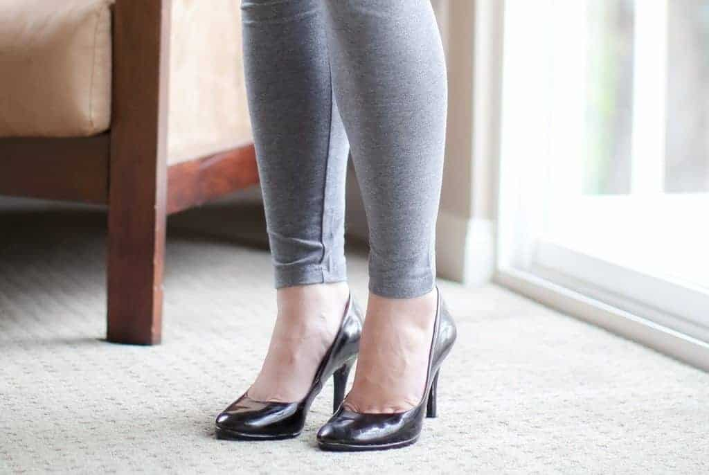 Close up of woman wearing black heels