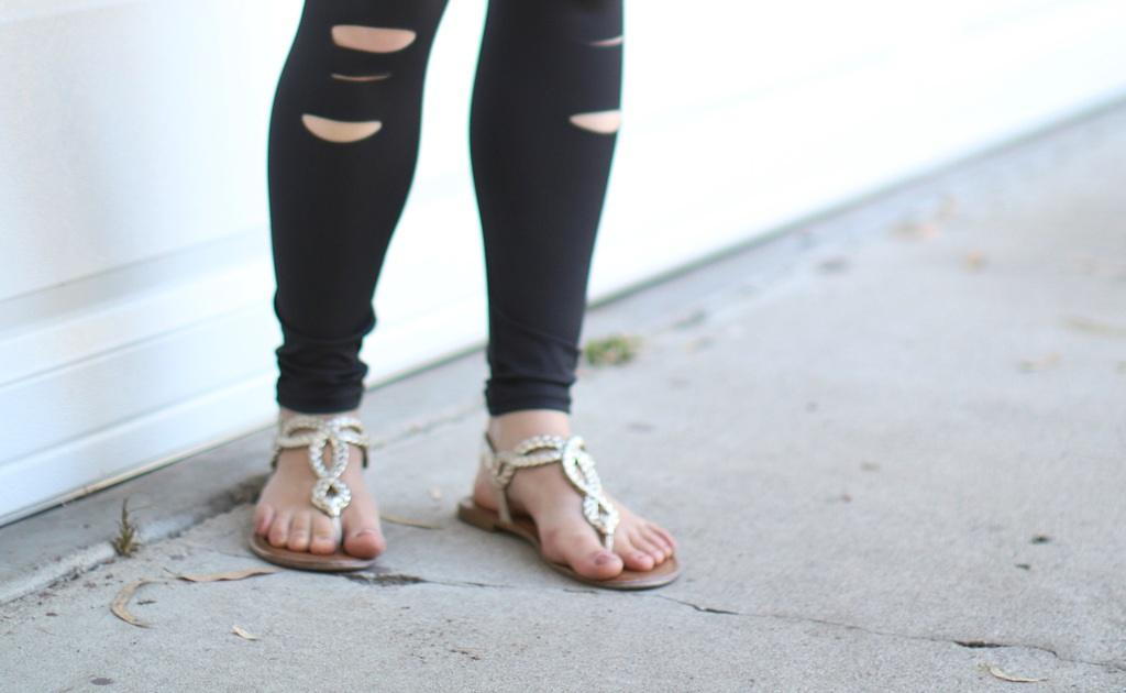 Close up of a woman wearing sandals