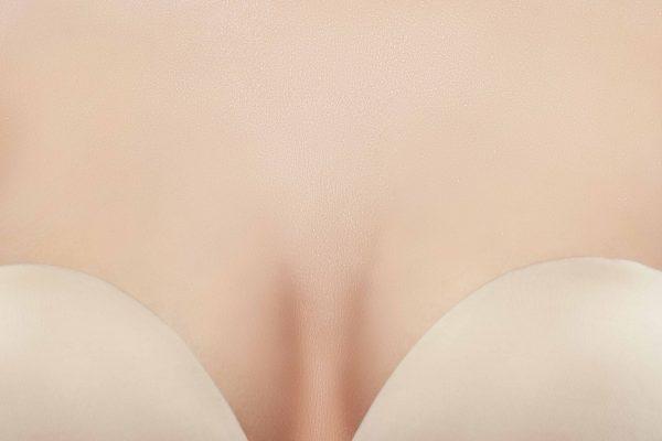 Woman wearing a flesh colored adhesive bra