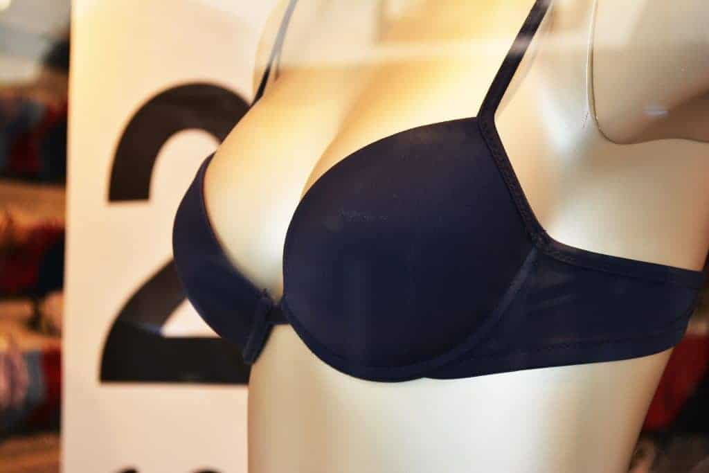 A mannequin with a woman figure wearing a black underwire bra