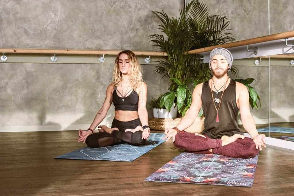 A man and a woman doing yoga