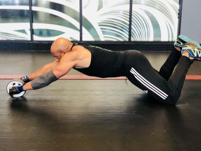 Man exercising while wearing shorts and leggings