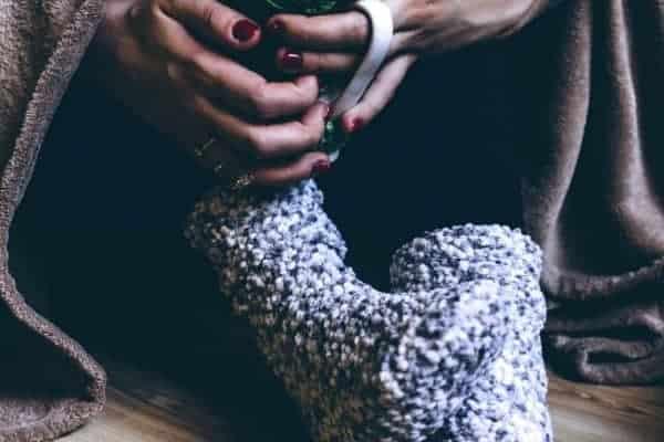 Woman wearing blue hand knitted socks
