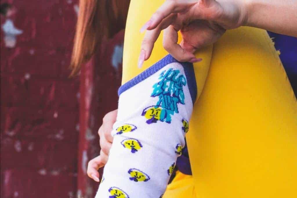 Girl wears socks over yellow leggings