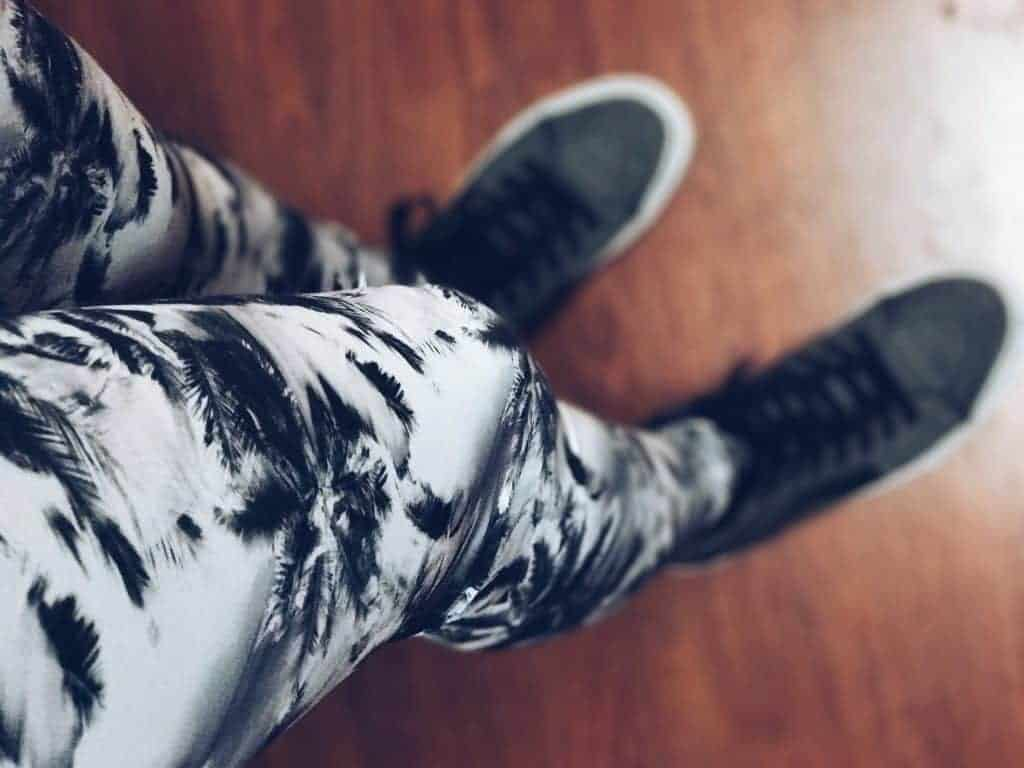 Girl wearing black and white designed leggings