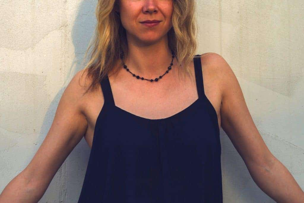 Woman wearing a black shirt with a black bra underneath