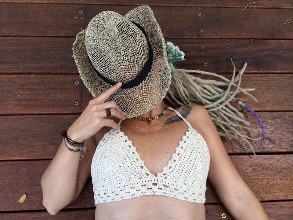 A woman wearing wearing a crocheted bralette