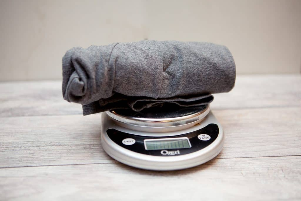 A pair of gray leggings on top of a weighing scale