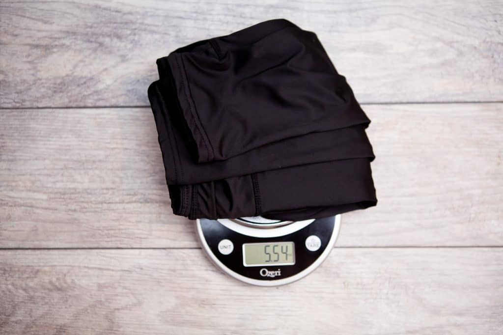 A pair of black leggings on top of a weighing scale