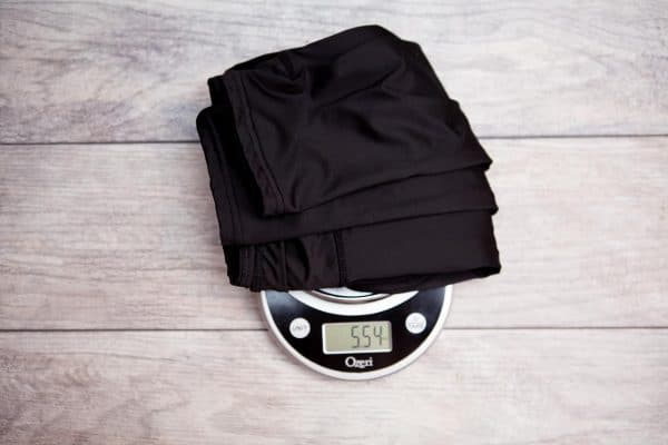 Folded black leggings placed on a weighing scale