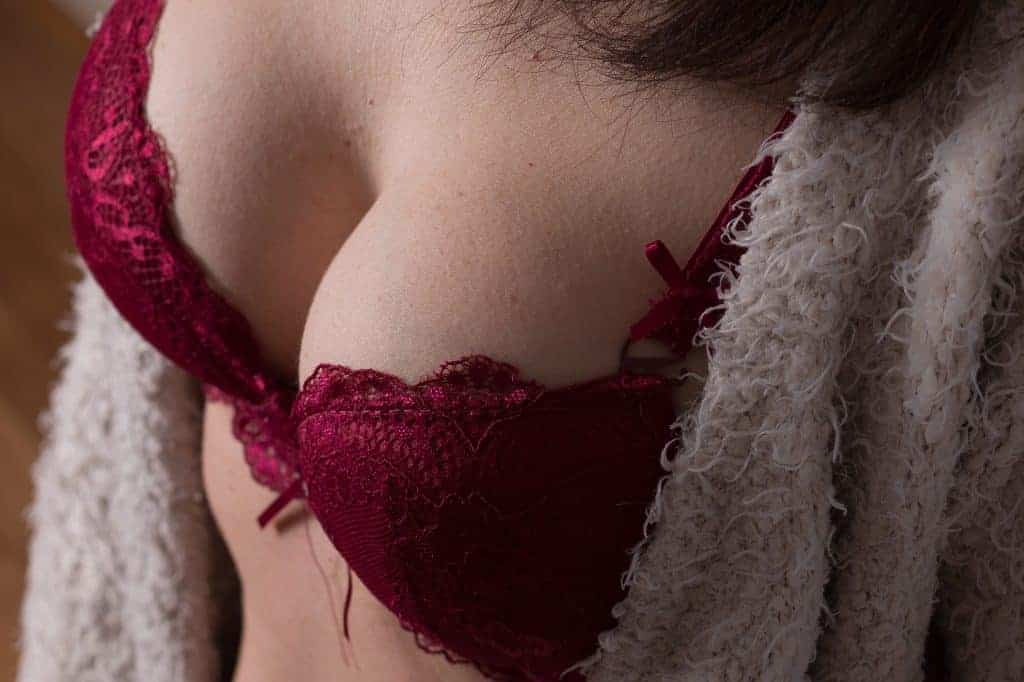 Woman wearing a lacy deep red bra