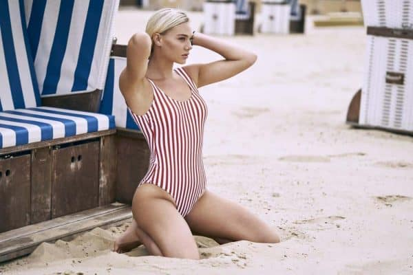 Woman wearing a striped one-piece swimsuit