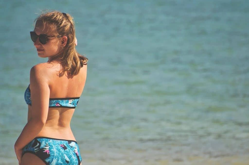 Woman wearing a bikini at the beach