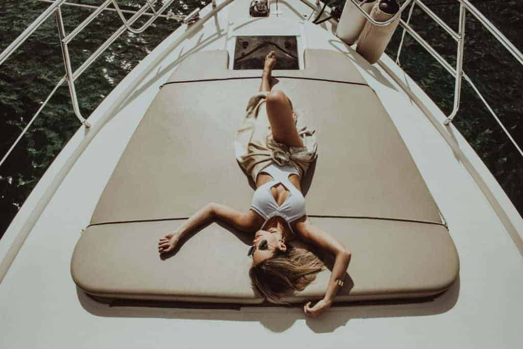 Woman in monokini lying on a boat