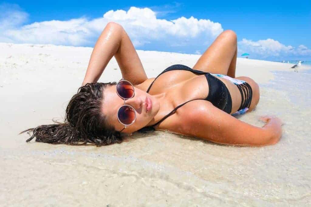 Woman sunbathing on seashore