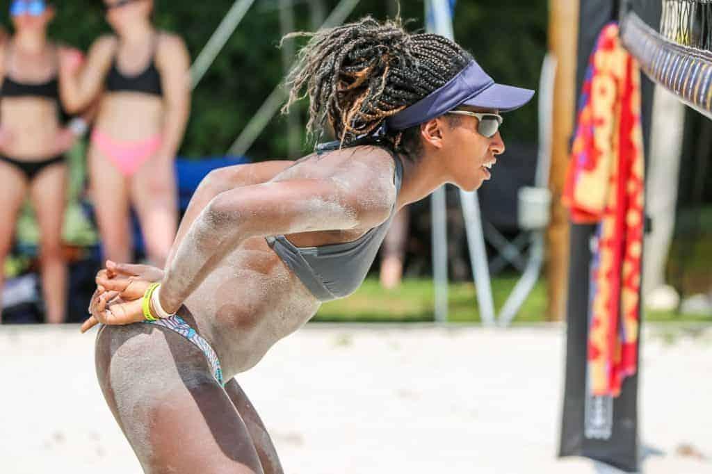 Woman in bikini playing beach volleyball