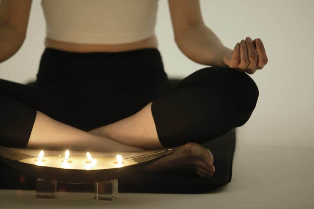 Woman doing yoga while wearing her leggings