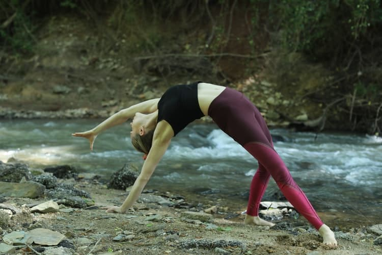 Woman doing yoga poses while wearing leggings