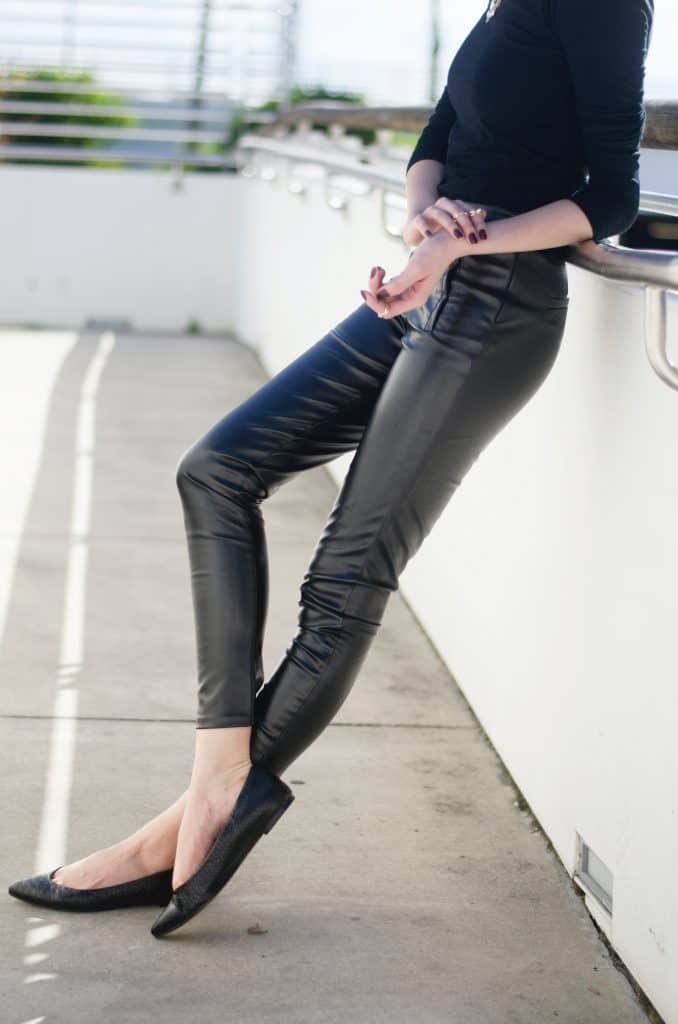 Close up of a person wearing faux leather leggings