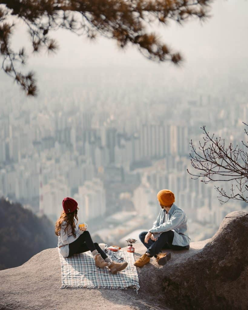 Couple enjoying the view after hiking