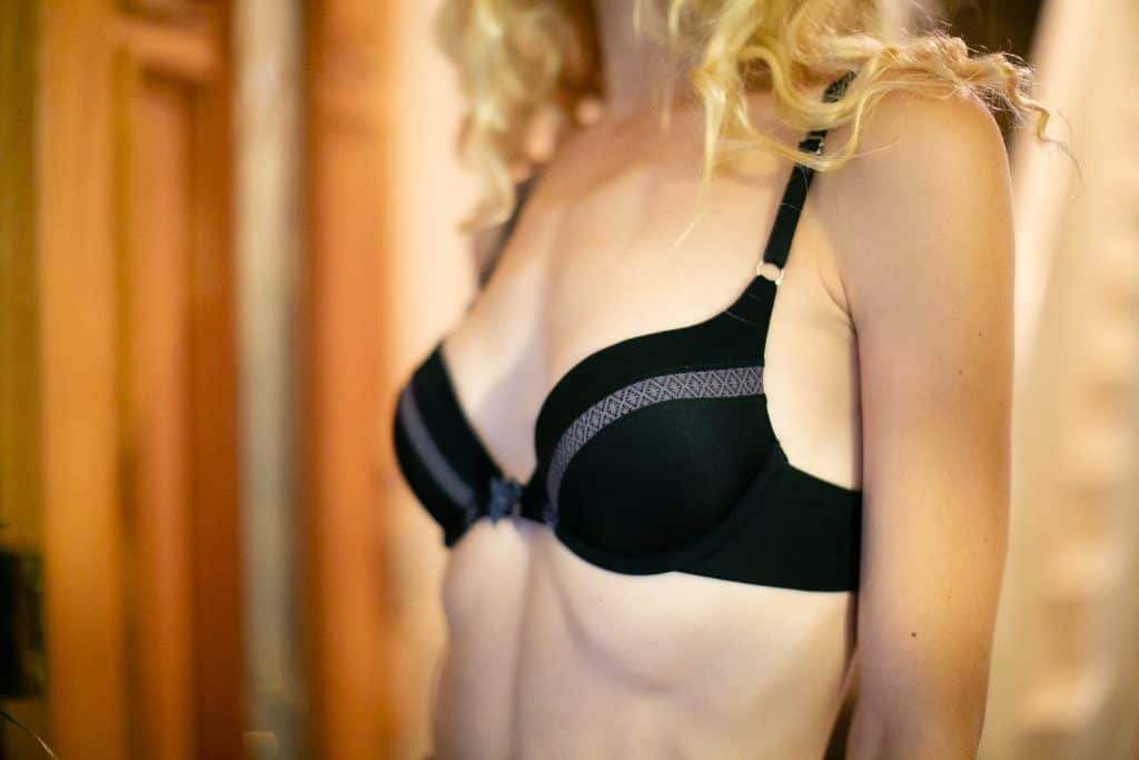 Woman wearing a black push up bra