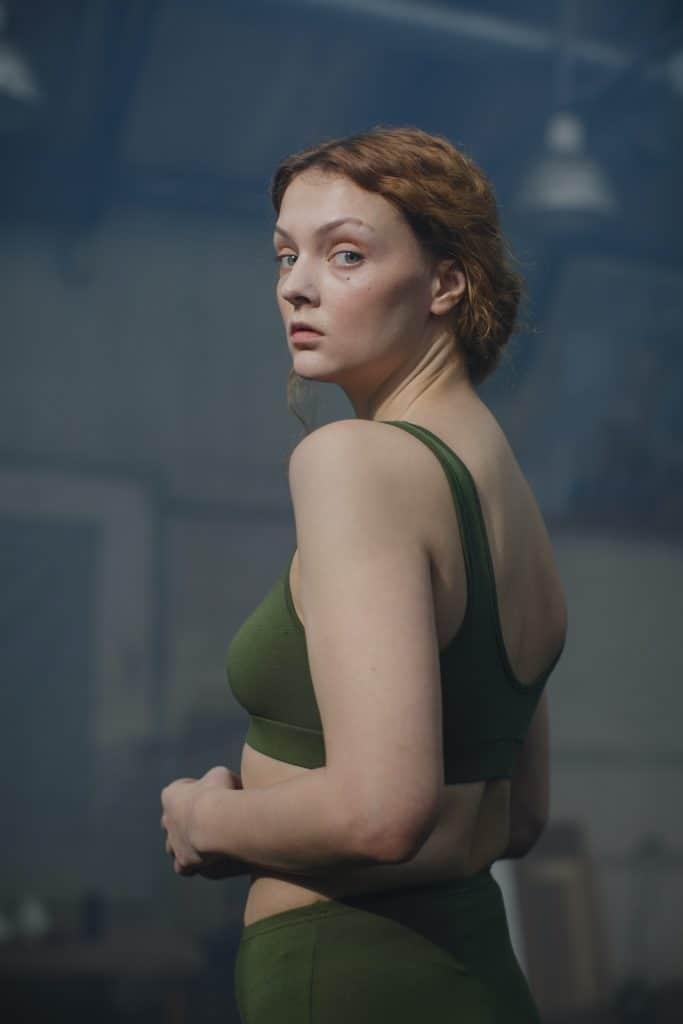 Woman wearing a green sports bra