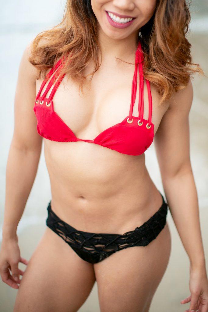 Woman wearing a red and black bikini
