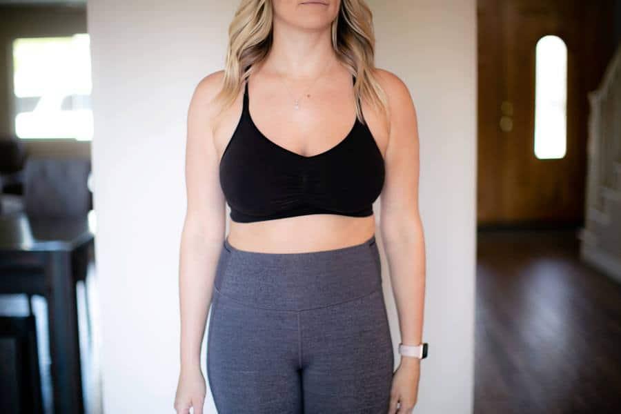 Woman wearing a black bra that helps her costochondritis