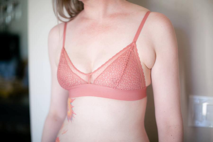 Woman wearing a peach colored bra