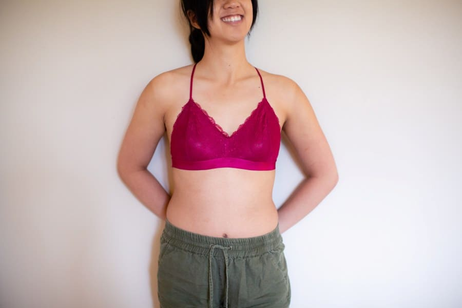 Woman wearing a red bra and green shorts
