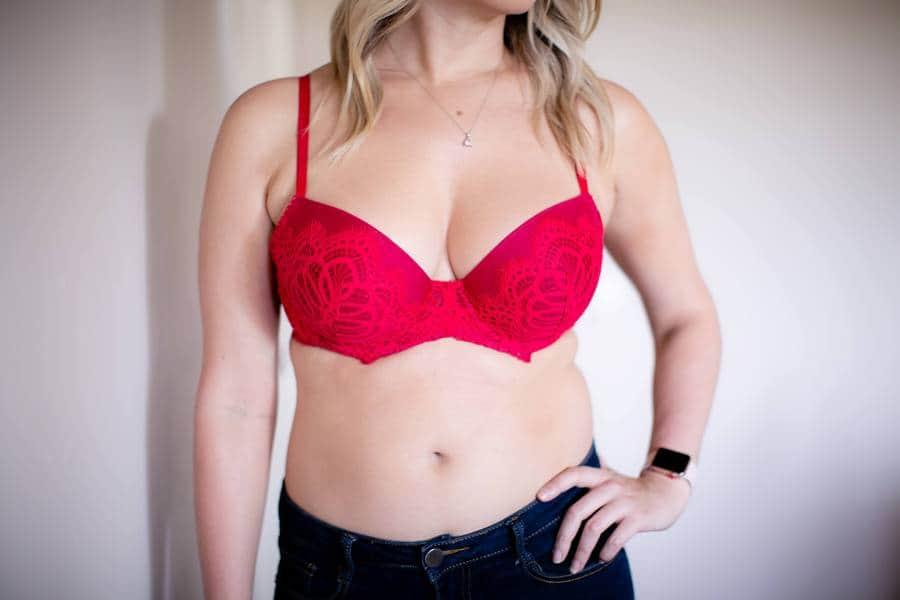 Woman wearing a red lace bra