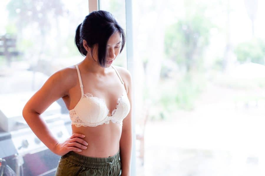 Woman wearing white bra with lace