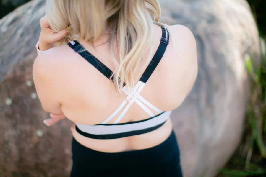 Woman showing the back straps of her sports bra