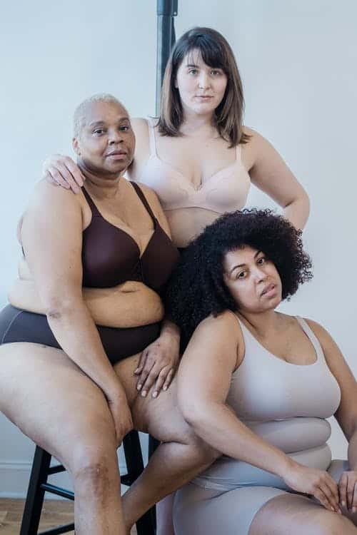 Three women in different types of undergarments