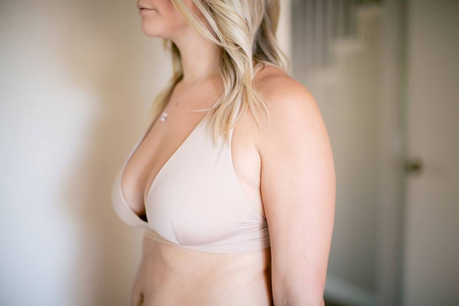 Woman wearing a nude colored bralette